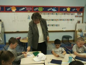 Sr. Connie offers a suggestion to help this little boy with his work.