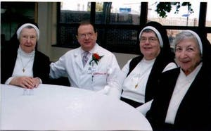 Sr. Ann Joseph chats with Srs. Albert Mary McSwiggin and Georgina Marmino and one of the medical center physicians.