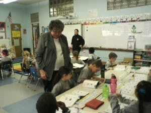 Sr. Connie is at hand if the children have a question about their workbook assignments.